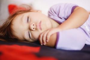 sleeping toddler girl is wearing a pajama